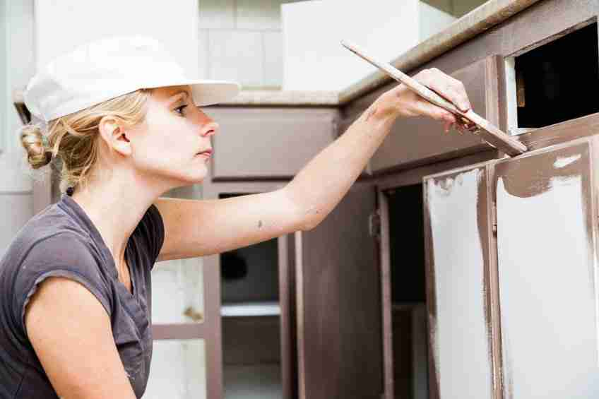 Painting Kitchen Cabinets With A Woman
