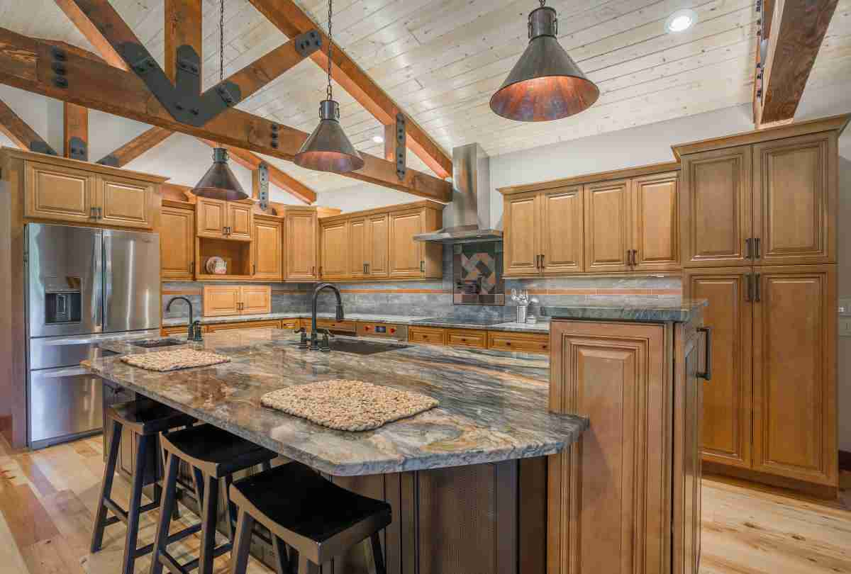 J&K Cabinetry Cinnamon Glazed Cabinet in Kitchen with Countertop