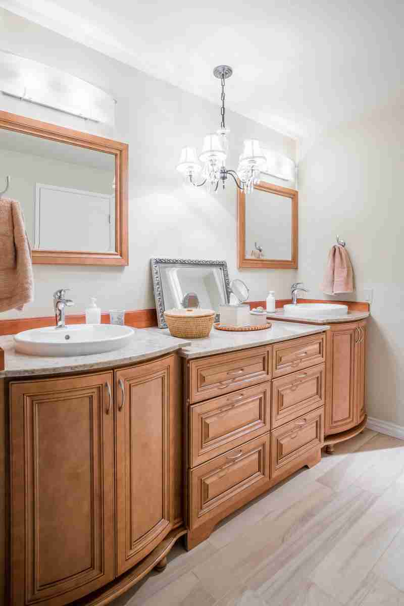 J&K Cabinetry Cinnamon Glazed Cabinet in Bathroom with Sink
