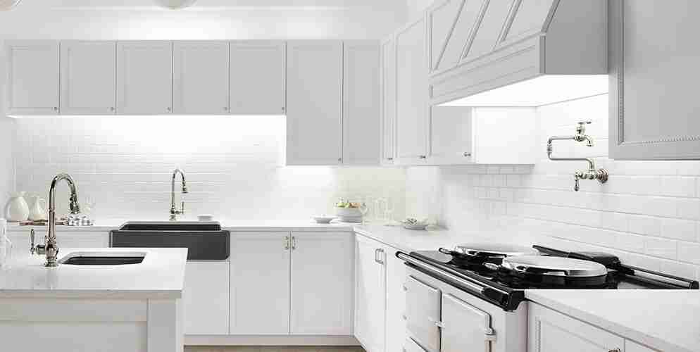 White Kitchen with Metal Appliances