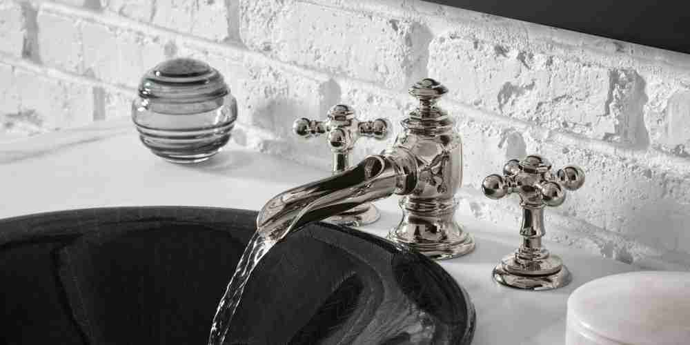 Metal Faucet and Black Sink